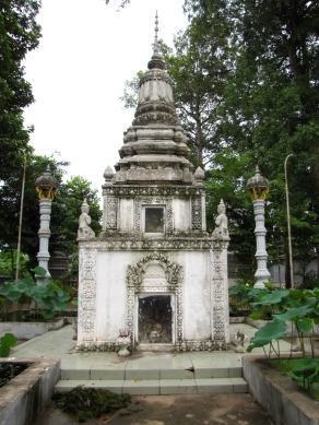 The cement memorial that replaced the original wooden memorial, tucked toward the side of the temple site - Wat Champuh Ka'ek, Kandal