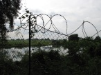Barbed wire to the lake - Choeung Ek, Kandal
