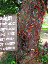 Memorial bracelets pinned to the tree - Choeung Ek, Kandal