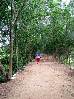 Shirley on the path round the back between the pond and the lake - Choeung Ek, Kandal