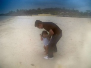 Father and daughter test out the sand - Kampong Som