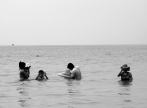 Family doing their thing in the water (while I bum on the sand) - Kampong Som