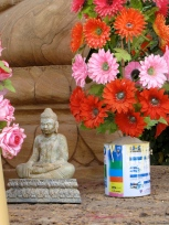 An old paint can, some cement, and fake flowers make decent shrine decor - Wat Tmei, Siem Reap