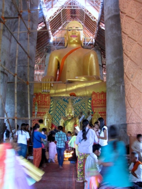 The legendary giant golden Buddha inside the Arthaross Temple, non-traditionally facing the east - Phnom Oudong, Kandal