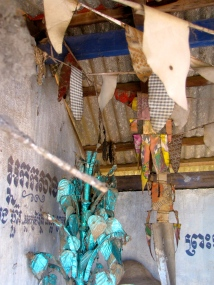 An altar made of fabrics, strings, metals, and beads - Phnom Oudong, Kandal