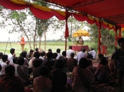 Audience listens to the priest at one of the many events during the morning of the stupa ceremony - Takeo