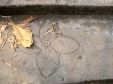 Common lotus flower motif drawn on a cement step - Phnom Chi Sol, Takeo