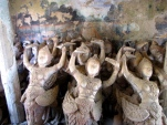 An older, unused genocide memorial on site was emptied of bone remains, the space replaced with statues that were removed from the temple's main site - Wat Samdech Mony, Battambang