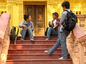 Chatting on the steps of a blindingly gold shrine - Wat Tha Loas Chah, Battambang (Photo by Angela Lim)