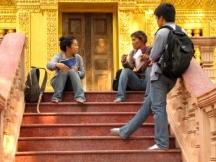Chatting on the steps of a blindingly gold shrine - Wat Tha Loas Chah, Battambang (Photo by Angela Lim)