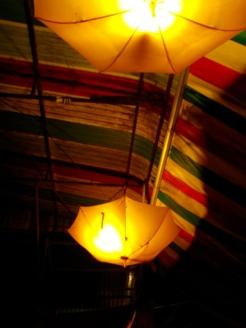 Umbrella lighting on the ceiling - Smokin' Pot Restaurant and Cooking School, Battambang