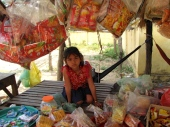 I failed at trying to buy a small piece of candy here, either because the little girl wouldn't sell me anything, or because she didn't understand what I was asking - Koan Ka'ek, Battambang