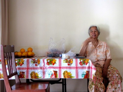 Aunt Sumpha sampling a batch of Orville Redenbacher's best popped goods - Home, Phnom Penh