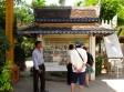 Yutney near an informational board near the memorials - Wat Tmei, Siem Reap