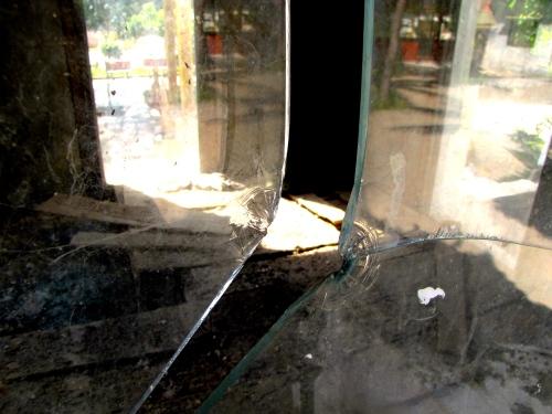 Cracked pane of the clear encasement in the old memorial - Wat Tmei, Siem Reap