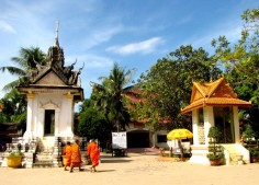 The two memorials against the landscape of trees - Wat Tmei, Siem Reap