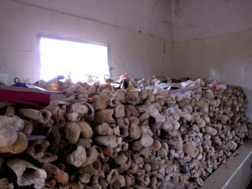 Bones stored on the left side when walking inside the genocide memorial - Wat Kampong Tralach, Kampot