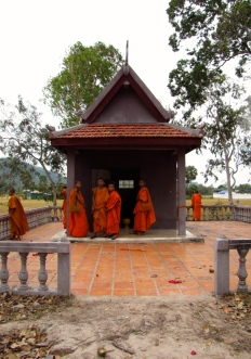 Local monks gather around the genocide memorial - Wat Kampong Tralach, Kampot