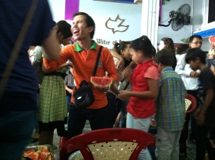 Easter fellowship with company, watermelon, and longan - Water of Life Church, Phnom Penh