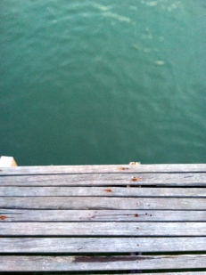 Looking into the water over the pier - Sailing Club, Kep