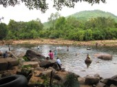 Khmer travelers stop by the river to take a dip, sit, and maybe splash - Kampot