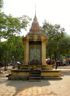 The memorial stands off alone in a quiet space, separate from the crowd and movement of the market across the street - Phnom Oudong, Kandal