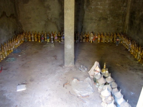 Urns containing the ashes of the remains that were initially cremated in the area before cremation practices were discouraged by government policies - Wat Chrey, Battambang