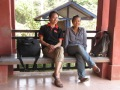 At a commune hall on break during fieldwork day with HelpAge staff member Angela Lim - Mount Russei, Battambang (Photo by Lee Nemo)
