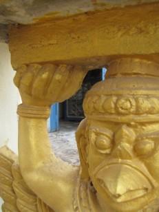 Looking through the pillars of the short fence encircling the memorial - Wat Tha Loas Chah, Battambang (Photo by Angela Lim)
