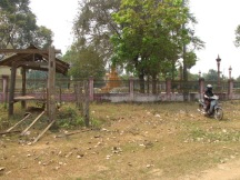 Inspecting what's left of the memorial from afar - Wat Russei, Battambang