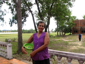 68-year old Sokpeak Chan Sen, who lives near the wat, grabbed the keys to open the memorial - Wat Kampong Tralach, Kampot