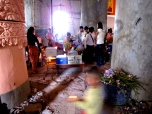 Pile of lotus stems lays off to the side in a busy old temple building - Phnom Oudong, Kandal