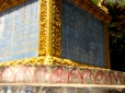 The petals of the lotus cradle around the top of the steps of the stupa - Wat Samdech Mony, Battambang