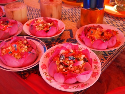Rosy-hued plates of lotus petals, jasmine buds, and candied confections laying on the altar at the stupa ceremony - Samroung, Takeo (Photo by Katie Markovich)