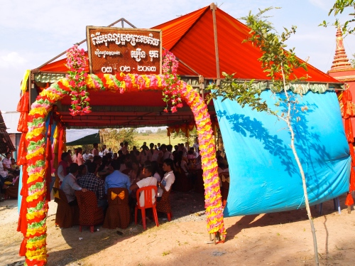 Tent of many colors shelters guests for the stupa dedication ceremony - Samroung, Takeo (Photo by Katie Markovich)