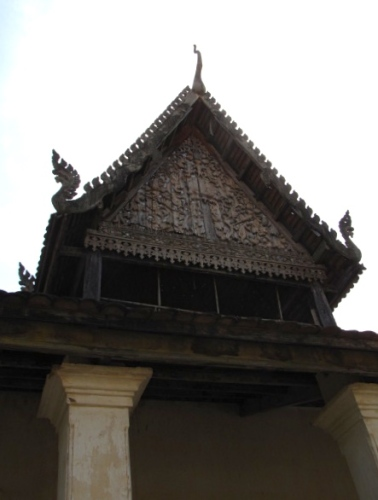 Wooden carvings on the roof of the old pagoda on site - Wat Samrong Knong, Battambang