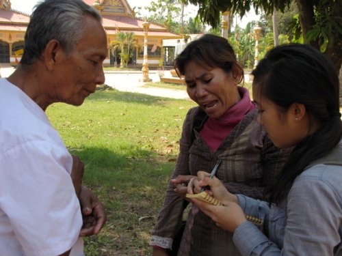 Sampov and I counseling with 71-year old Lang Chhay Vuon Yen, the lounger we bumped into at the temple - Wat Chrey, Battambang (Photo by Angela Lim)